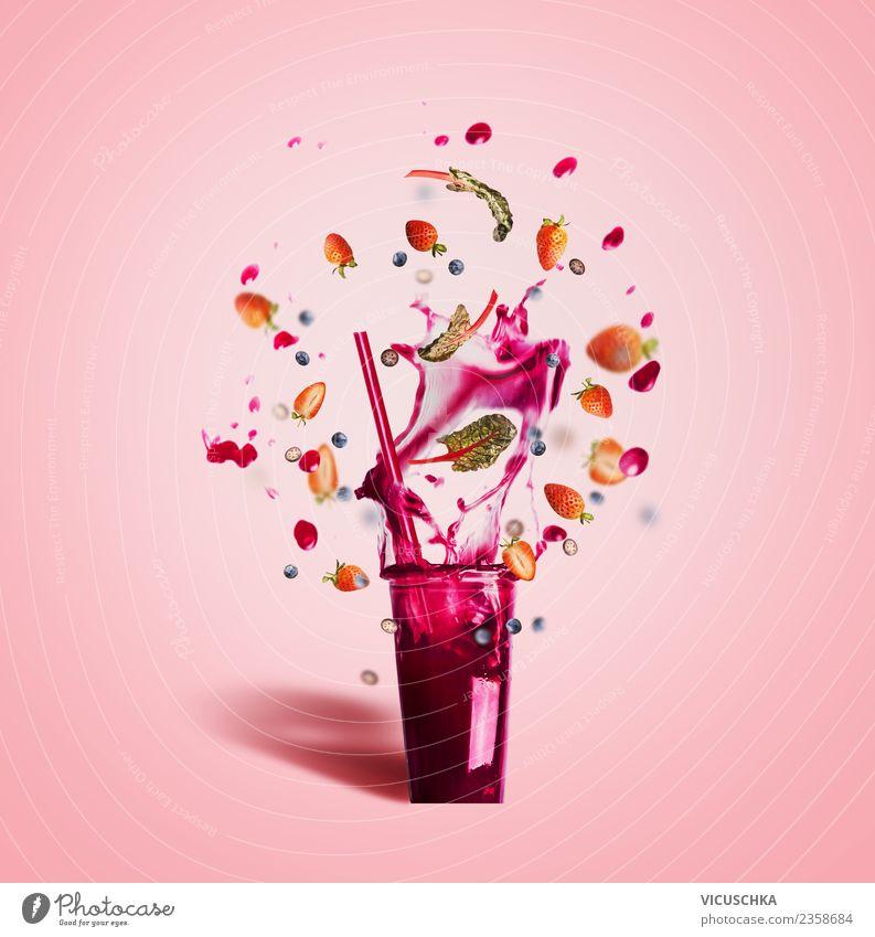 Fruit summer drink splashes out of the glass Food Beverage Cold drink Lemonade Juice Style Design Healthy Healthy Eating Summer Hip & trendy Pink Milkshake