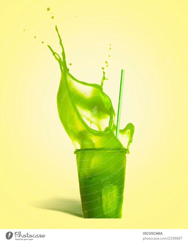 Green summer drink splashes out of the glass Beverage Cold drink Lemonade Juice Glass Style Design Healthy Healthy Eating Life Summer Bar Cocktail bar Yellow