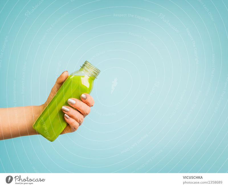 Hand with green smoothie bottle Beverage Cold drink Lemonade Juice Style Design Healthy Healthy Eating Summer Human being Feminine Woman Adults Vitamin Bottle