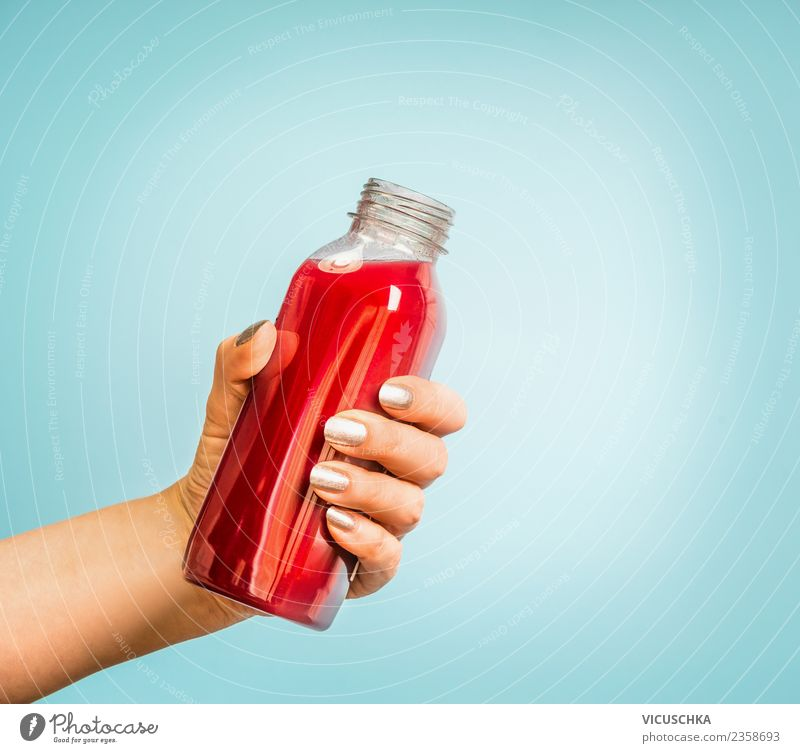 Hand with juice or smoothie bottle Beverage Cold drink Lemonade Juice Style Design Healthy Healthy Eating Summer Human being Feminine Woman Adults Vitamin