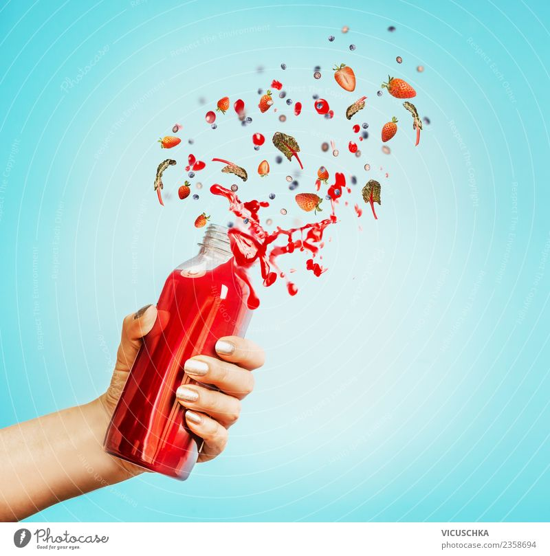 Hand with berry juice or smoothie bottle Fruit Organic produce Vegetarian diet Diet Beverage Cold drink Juice Bottle Lifestyle Style Design Healthy