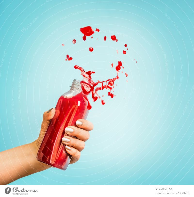 Hand with red juice or smoothie bottle Beverage Cold drink Juice Bottle Lifestyle Shopping Style Design Healthy Healthy Eating Summer Human being Feminine Woman