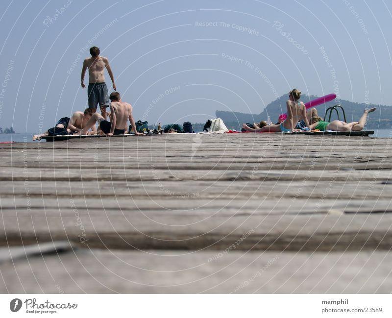 On the footbridge Footbridge Wooden board Man Woman Bikini Italy Lake Ocean San Felice del Benaco Lake Garda Europe Human being Youth (Young adults) swimwear