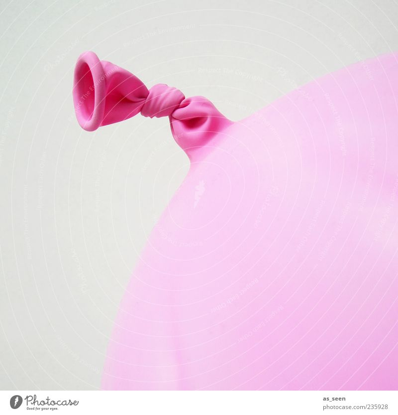 Pink Balloon Round Plastic Make Knot Partially visible Rubber Node Bright background