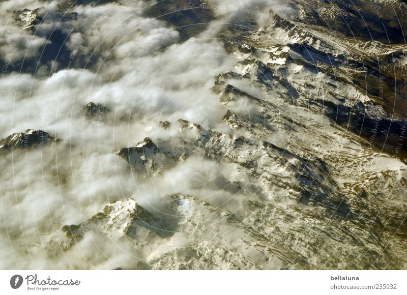 Sky Nature White Summer Winter Clouds Environment Landscape Snow Mountain Rock Alps Beautiful weather Peak Snowcapped peak Aerial photograph