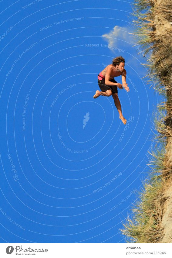 Human being Sky Man Nature Youth (Young adults) Blue Vacation & Travel Summer Beach Joy Adults Freedom Grass Coast Jump Style