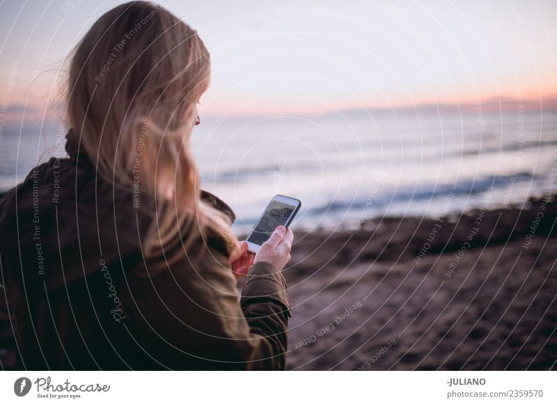Young woman at the beach using her smartphone Beach Dusk Emotions Happy Life Lifestyle Spain Summer Sun Sunset Warmth Adventure Communication Freedom Joy Good