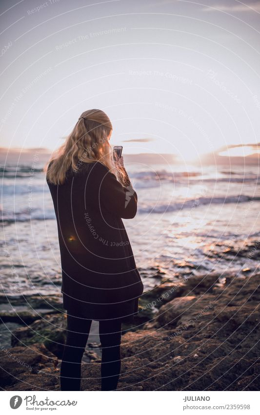 Young woman is taking picture of sunset at the beach Beach Dusk Emotions Happy Life Lifestyle Spain Summer Sun Sunset Warmth Adventure Communicate Communication