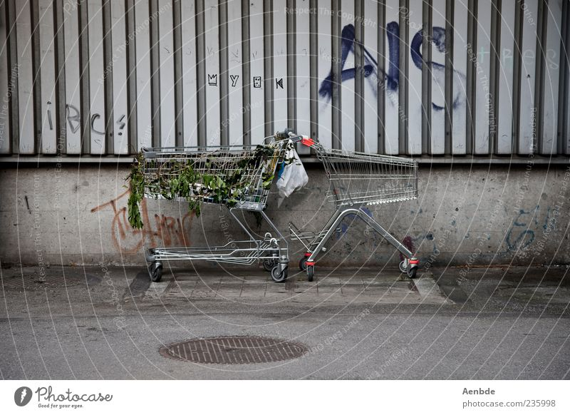 We have to go shopping again! Authentic Carriage Shopping Trolley Trash Paper bag Street Graffiti Parking Colour photo Subdued colour Exterior shot Day Daub