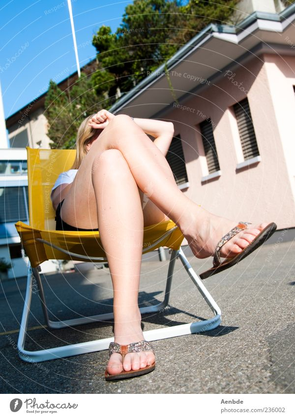 Human being Summer Joy House (Residential Structure) Yellow Feminine Happy Legs Feet Chair Asphalt Beautiful weather Sunbathing Knee Flip-flops Woman's leg