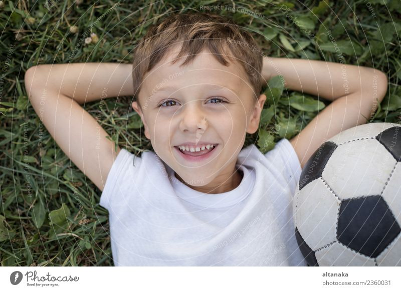 Portrait of a young boy with soccer ball. Concept of sport. Lifestyle Joy Happy Relaxation Leisure and hobbies Playing Summer Sports Soccer Child Human being