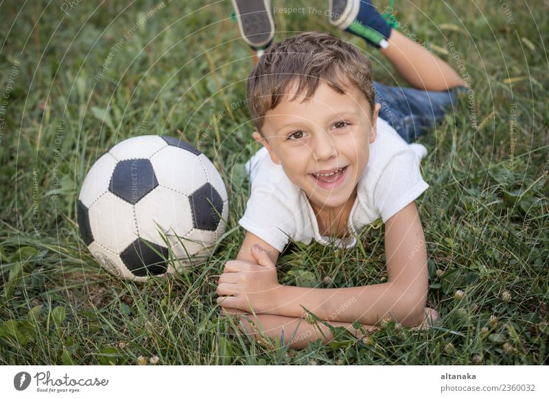 Portrait of a young boy with soccer ball. Child Human being Man Summer Green Relaxation Joy Adults Lifestyle Sports Movement Family & Relations Grass