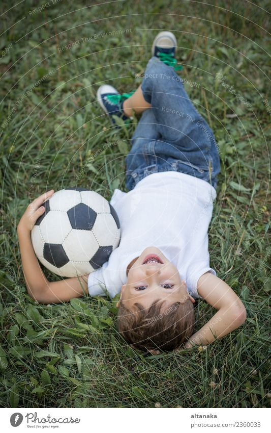 Portrait of a young boy with soccer ball. Lifestyle Joy Happy Relaxation Leisure and hobbies Playing Summer Sports Soccer Child Human being Boy (child) Man