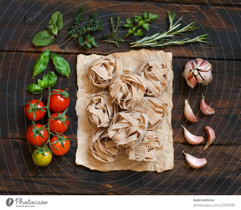 Whole wheat pasta tagliatelle, vegetables and herbs Vegetarian diet Diet Table Leaf Dark Fresh Brown Green Red Tradition cooking food health healthy Ingredients