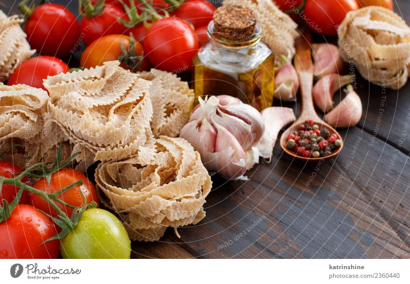 Whole wheat pasta tagliatelle, vegetables and herbs Herbs and spices Vegetarian diet Diet Bottle Table Dark Fresh Brown Red Tradition cooking food health