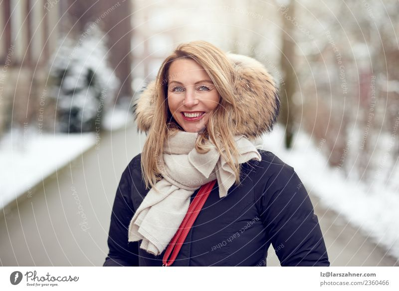 Friendly young blond woman outdoors in winter Lifestyle Happy Beautiful Face Winter Snow Woman Adults 1 Human being 45 - 60 years Park Fashion Coat Fur coat