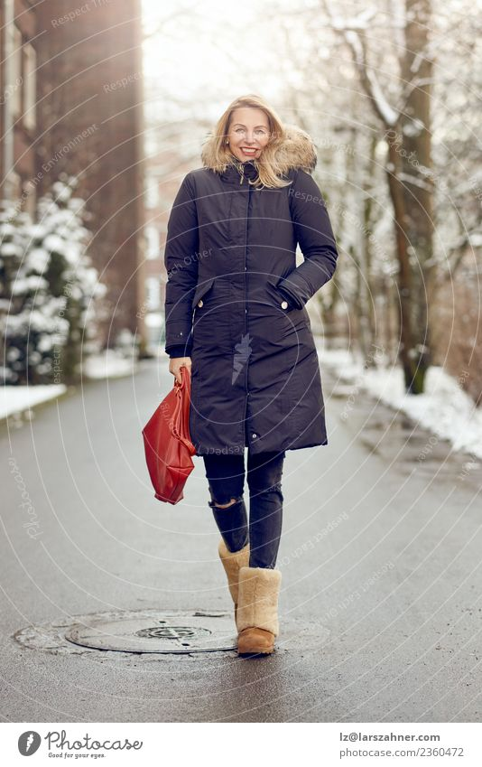 Attractive young blond woman in warm winter coat Lifestyle Happy Beautiful Face Winter Snow Woman Adults 1 Human being 45 - 60 years Park Street Fashion Coat
