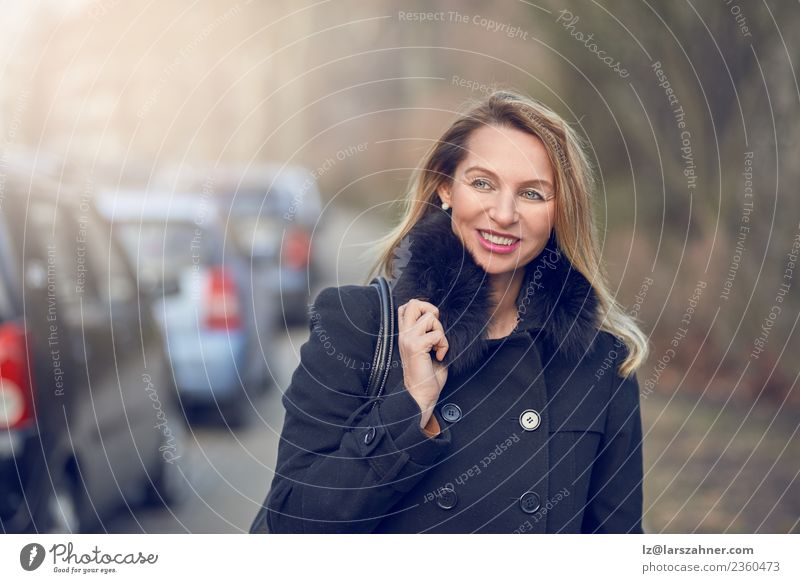 Attractive stylish smiling woman in a misty street Woman Human being Face Adults Street Lifestyle Autumn Style Business Copy Space Car Fog Modern Blonde