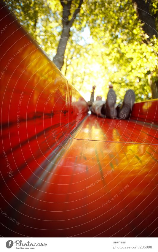Human being Red Summer Joy Adults Life Playing Footwear Lie Masculine Happiness Joie de vivre (Vitality) Playground Motion blur Slide Toys