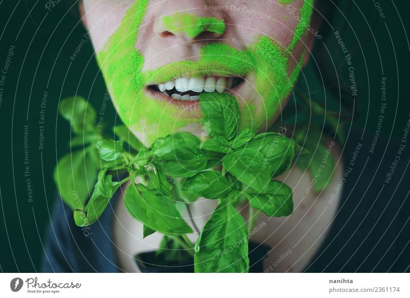Young woman biting a basil leaf Food Vegetable Basil Nutrition Eating Organic produce Vegetarian diet Style Design Exotic Skin Face Human being Feminine