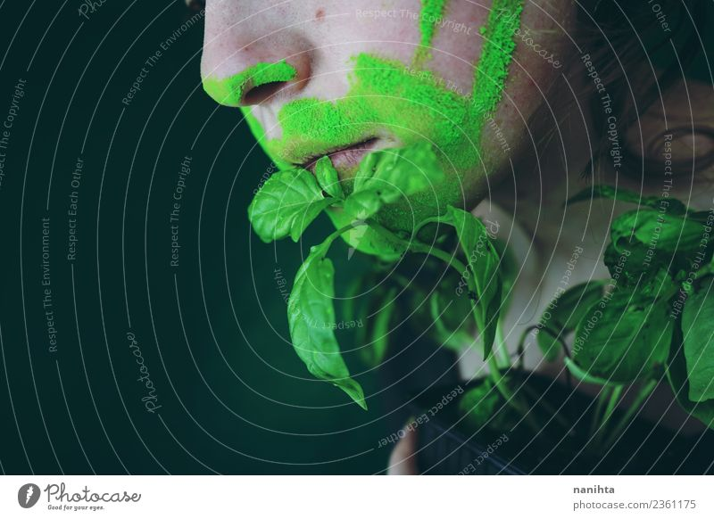 Close up of a young woman's mouth and a plant Food Nutrition Eating Organic produce Vegetarian diet Basil Design Exotic Human being Feminine Young woman