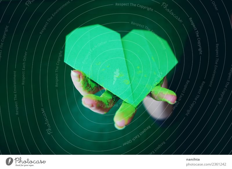 Hand holding a green paper heart Green Dark Love Art Together Design Dirty Authentic Heart Idea Paper Simple Sign Protection Exotic