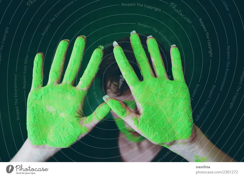 Young woman with hands dirty of green paint Woman Human being Youth (Young adults) Green Young man Hand Dark 18 - 30 years Adults Feminine Style Art Design