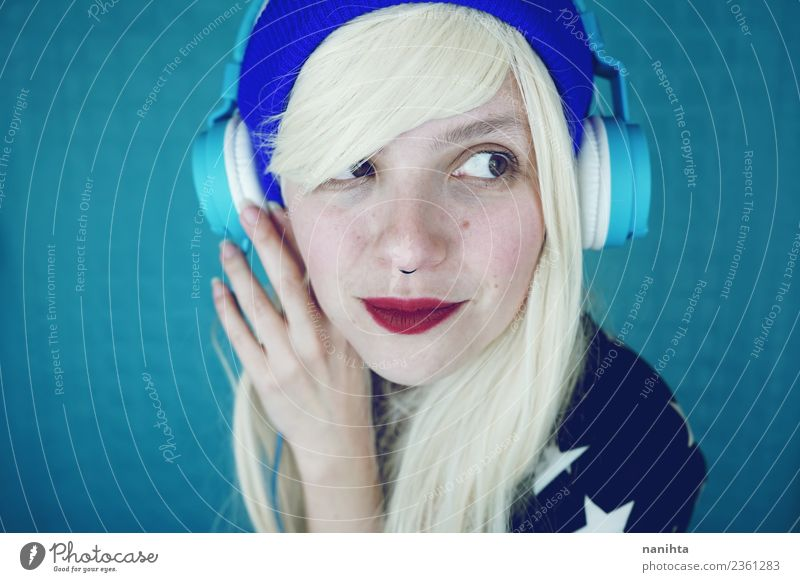 Young funny woman listening to music Lifestyle Style Design Hair and hairstyles Skin Face Leisure and hobbies Headset Technology Entertainment electronics