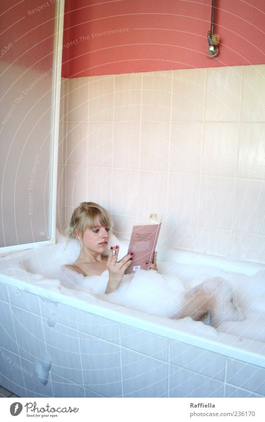 Youth (Young adults) Hand Beautiful Calm Relaxation Adults Contentment Blonde Pink Flat (apartment) Book Lie Swimming & Bathing Living or residing Bathroom