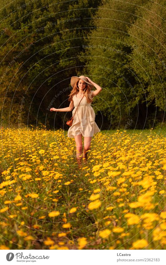 Young smiling woman running in a field of daisies Human being Nature Vacation & Travel Youth (Young adults) Young woman Summer Flower Joy 18 - 30 years Adults