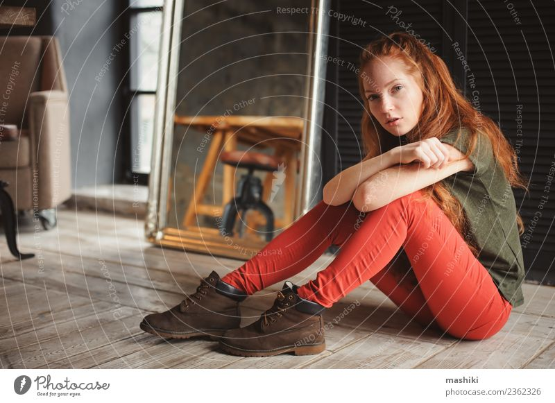 indoor portrait of beautiful young redhead woman Lifestyle Style Relaxation Woman Adults Youth (Young adults) Fashion Boots Red-haired Wood Metal Dark Modern