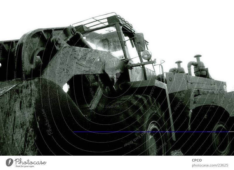 Excavator 1 Construction vehicle Construction site Wide angle Vehicle Electrical equipment Technology Black & white photo excavator wheel