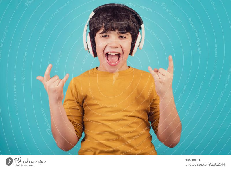 Boy with headphones showing rock sigh Child Human being Joy Lifestyle Emotions Laughter Boy (child) Party Feasts & Celebrations Leisure and hobbies Masculine