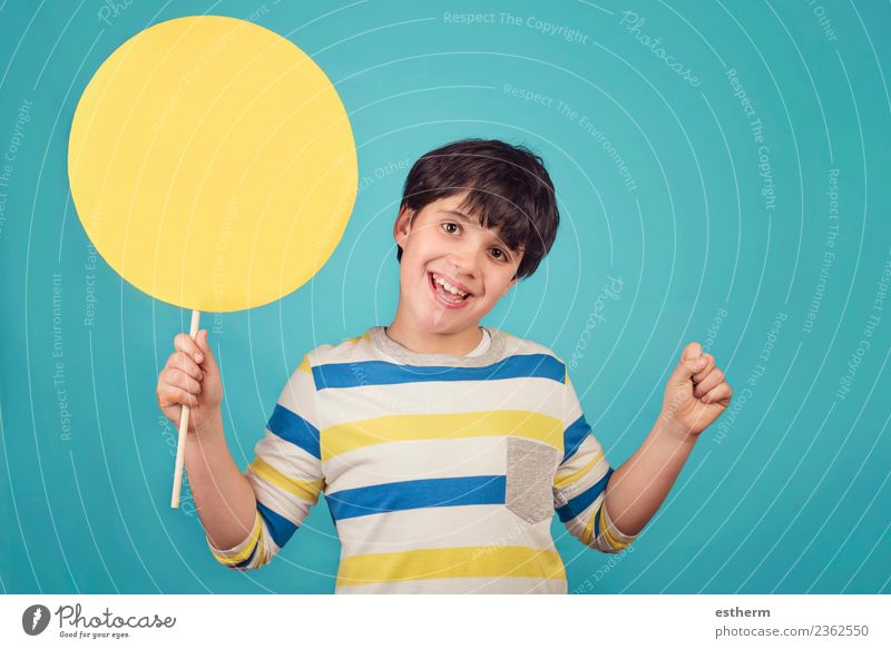 Boy holding a yellow sign on blue background Child Human being Joy Lifestyle Emotions Laughter Party Feasts & Celebrations Masculine Infancy Birthday Happiness