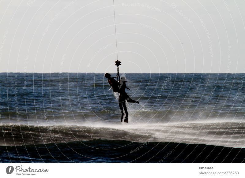 at the last second Ocean Human being 2 Water Flying Blue Bravery Determination Rescue Rope water rescue Accident Colour photo Exterior shot Detail