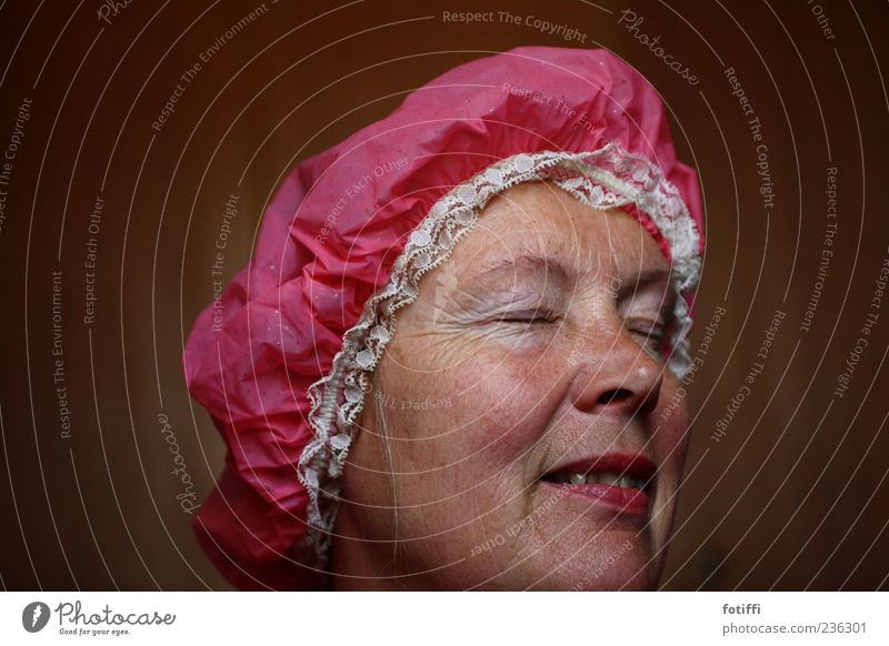 pointed (jack) cap II Human being Adults Skin Face Eyes Nose Mouth 1 45 - 60 years Shower cap Pink Lace Colour photo Interior shot Close-up