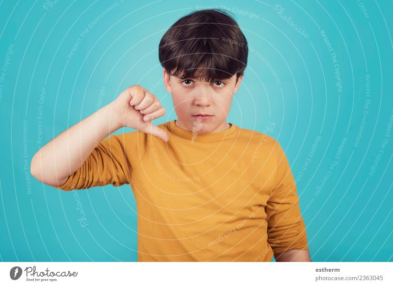 sad boy on blue background Lifestyle Human being Masculine Child Boy (child) Infancy 1 8 - 13 years To talk Fitness Sadness Gloomy Emotions Loneliness Guilty