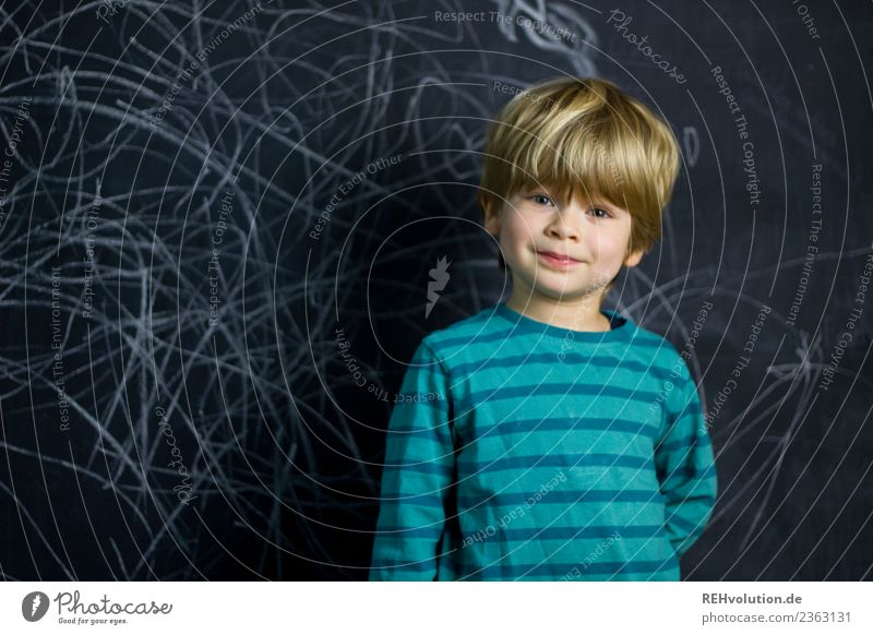 Boy stands in front of a blackboard wall Leisure and hobbies Parenting Education Kindergarten Study Schoolchild Human being Masculine Child Boy (child) 1