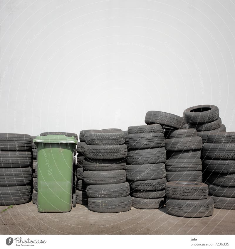 Wall (building) Wall (barrier) Facade Lie Many Tire Stack Storage Rubber Trash container Consecutively Car tire Bright background