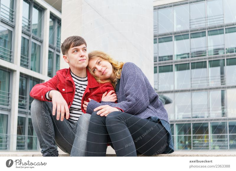 young couple sitting on the stairs in front of a modern building Lifestyle Human being Young woman Youth (Young adults) Young man Woman Adults Man Friendship