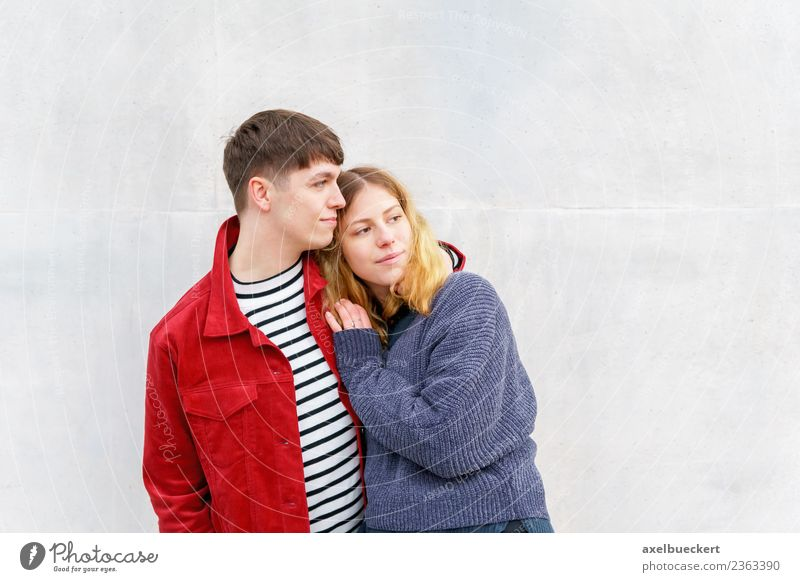 young loving couple standing in front of the concrete wall Lifestyle Human being Young woman Youth (Young adults) Young man Woman Adults Man Friendship Couple
