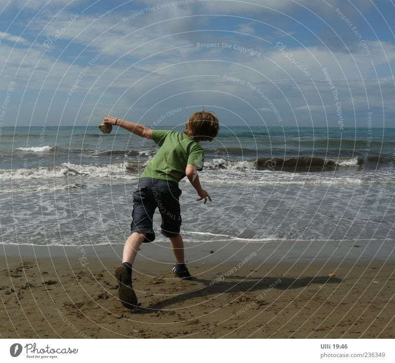 Slingshot. Life Playing Child Boy (child) 1 Human being 8 - 13 years Infancy Sand Water Sky Clouds Horizon Beautiful weather Wind Waves Coast Beach Ocean