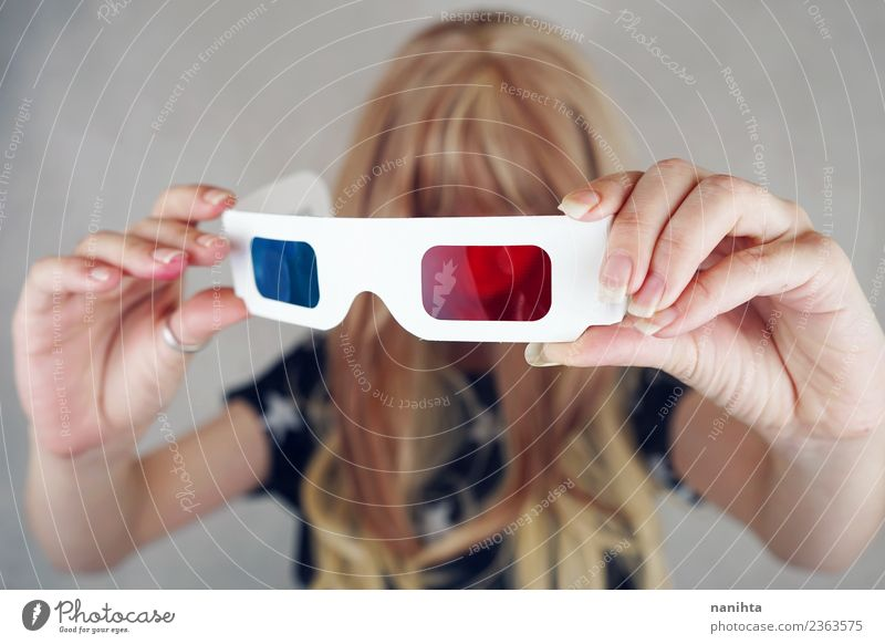 Young woman holding retro 3D glasses Lifestyle Style Design Leisure and hobbies Entertainment Going out Human being Feminine Youth (Young adults) 1