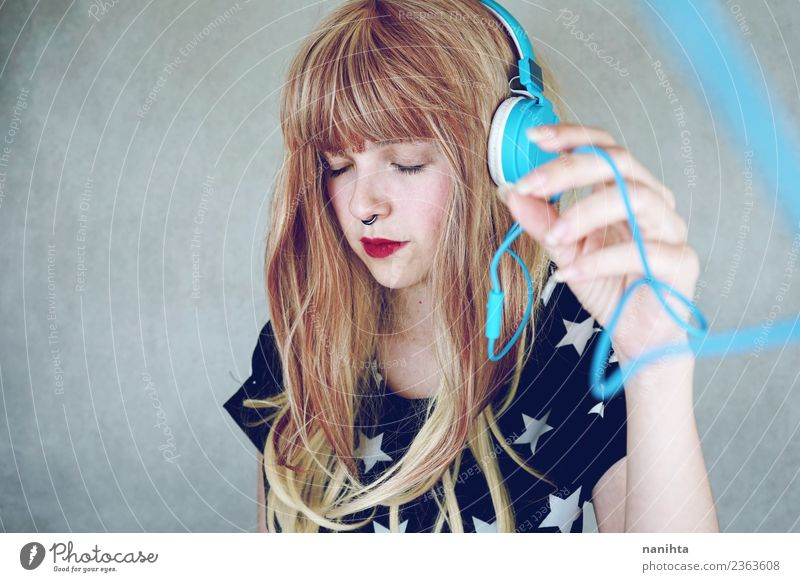 Young woman listening to music Lifestyle Style Design Beautiful Hair and hairstyles Senses Relaxation Leisure and hobbies Headset Technology