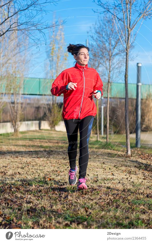 Runner woman jogging at the park Lifestyle Happy Beautiful Relaxation Leisure and hobbies Winter Sports Track and Field Sportsperson Jogging Work and employment