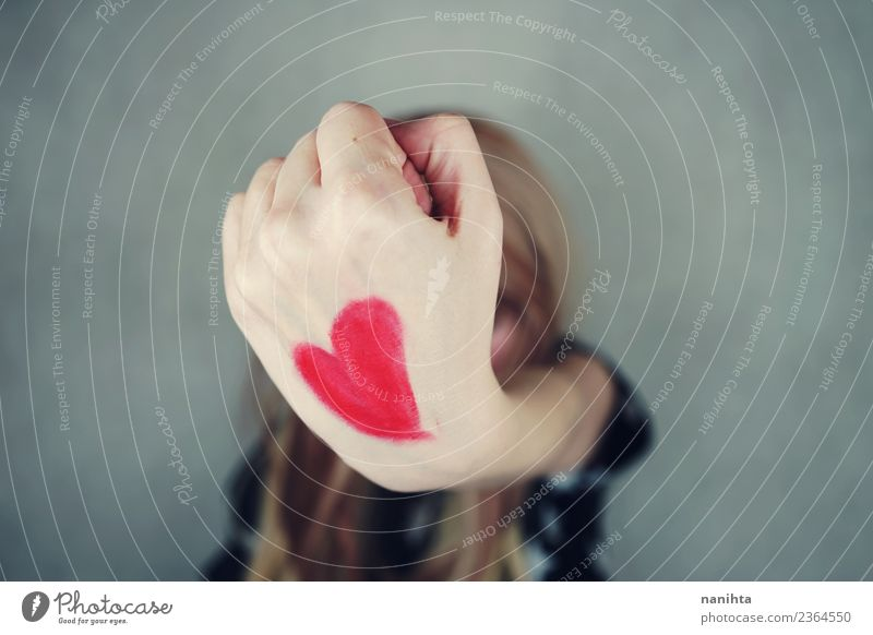 Young woman with a red heart painted in her hand Human being Youth (Young adults) Hand Joy 18 - 30 years Adults Life Healthy Love Feminine Health care Style