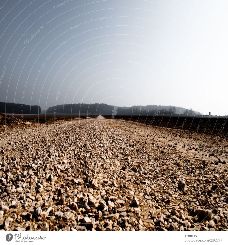 The straight path Traffic infrastructure Street Lanes & trails Infinity Blue Gray Gravel Gravel path Exterior shot Deserted Copy Space top Day Sunlight