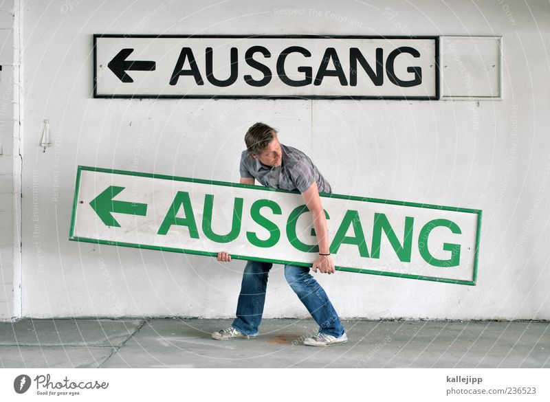 Human being Man Green Black Adults Wall (building) Wall (barrier) Signs and labeling Masculine Characters End Arrow Direction Carrying Way out