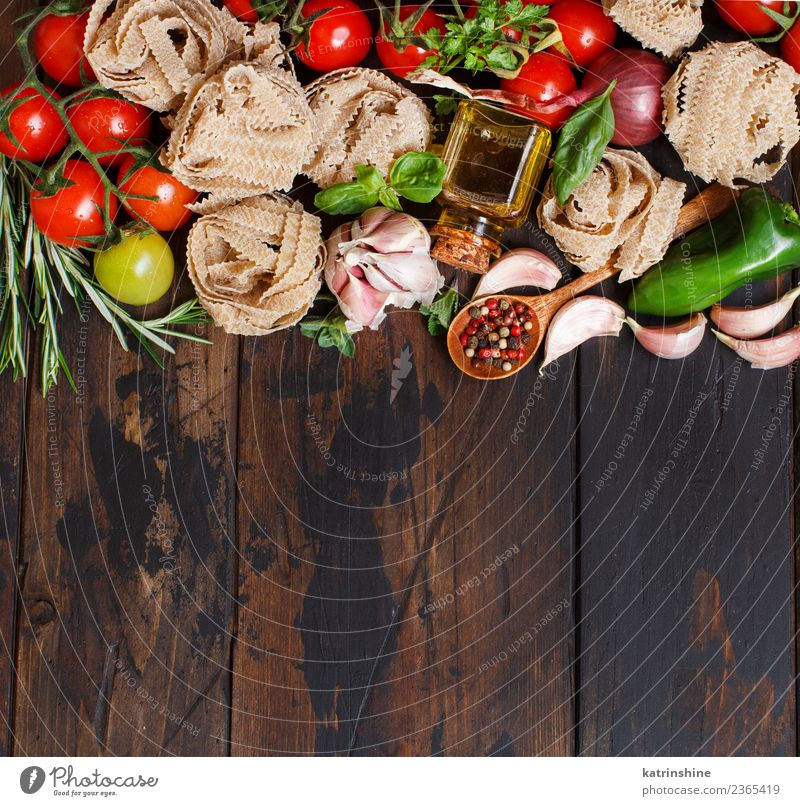 Fresh raw vegetables and herbs on a wooden background Vegetarian diet Diet Table Leaf Dark Brown Green Red cooking food health healthy Ingredients Rustic Tomato