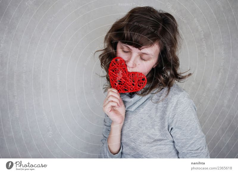 Young woman holding a red heart Design Healthy Wellness Harmonious Senses Relaxation Calm Human being Feminine Youth (Young adults) 1 18 - 30 years Adults